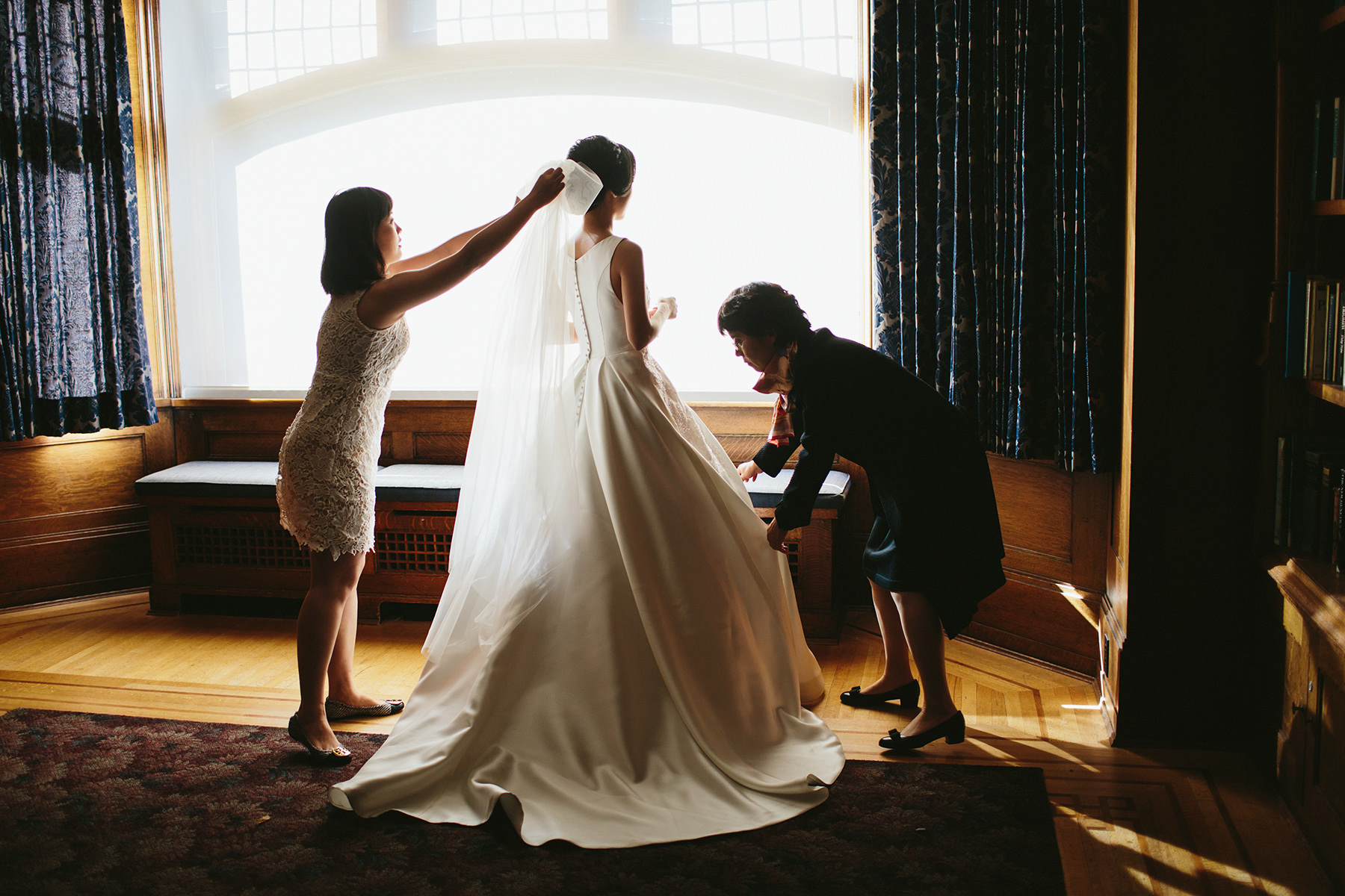 a Vancouver bride gets dressed in the Cecil Green Park House library www.lucida-photography.com