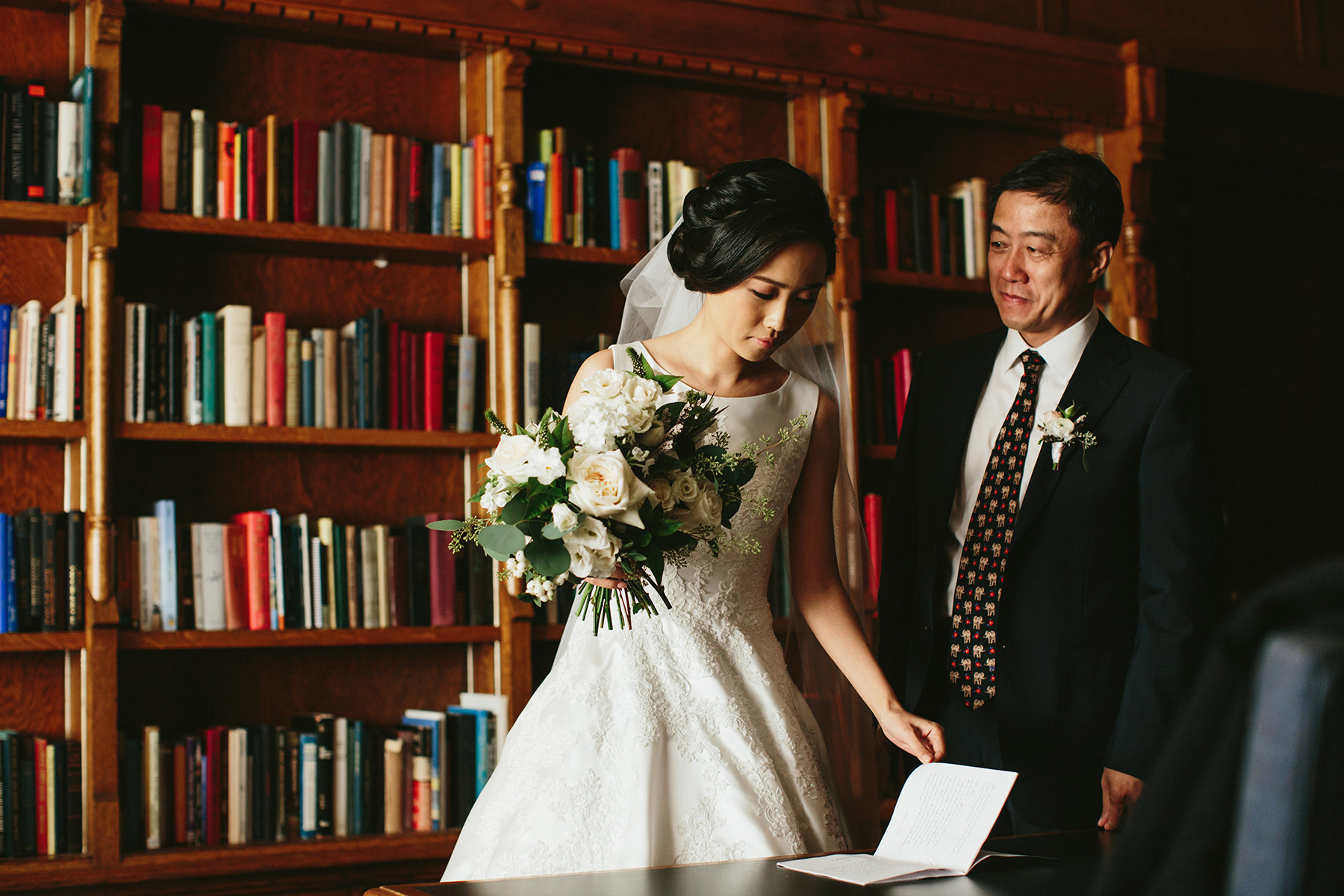 father of the bride in the Cecil Green Park House library www.lucida-photography.com