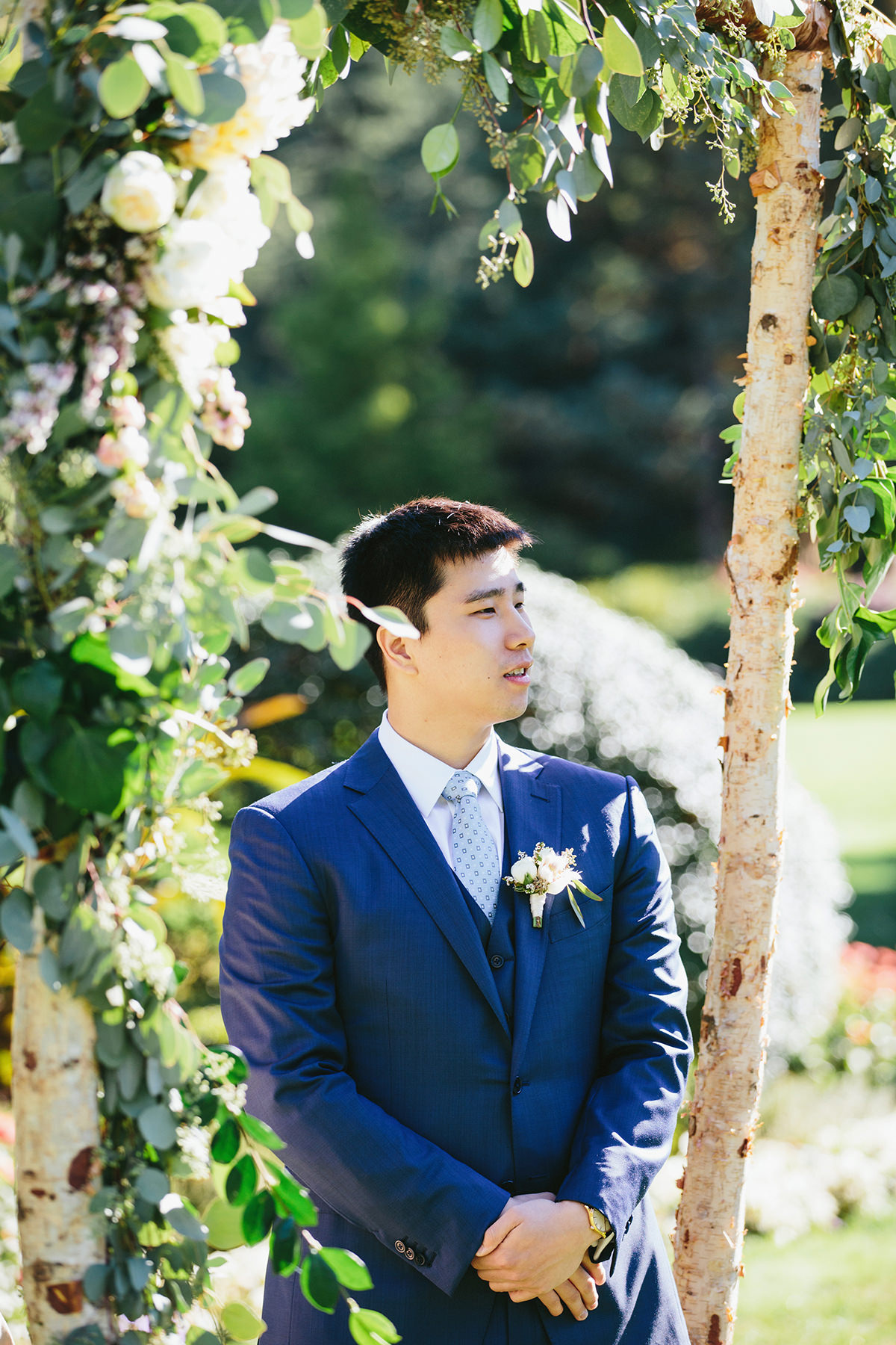groom waits at the end of the aisle at Cecil Green Park House at UBC www.lucida-photography.com