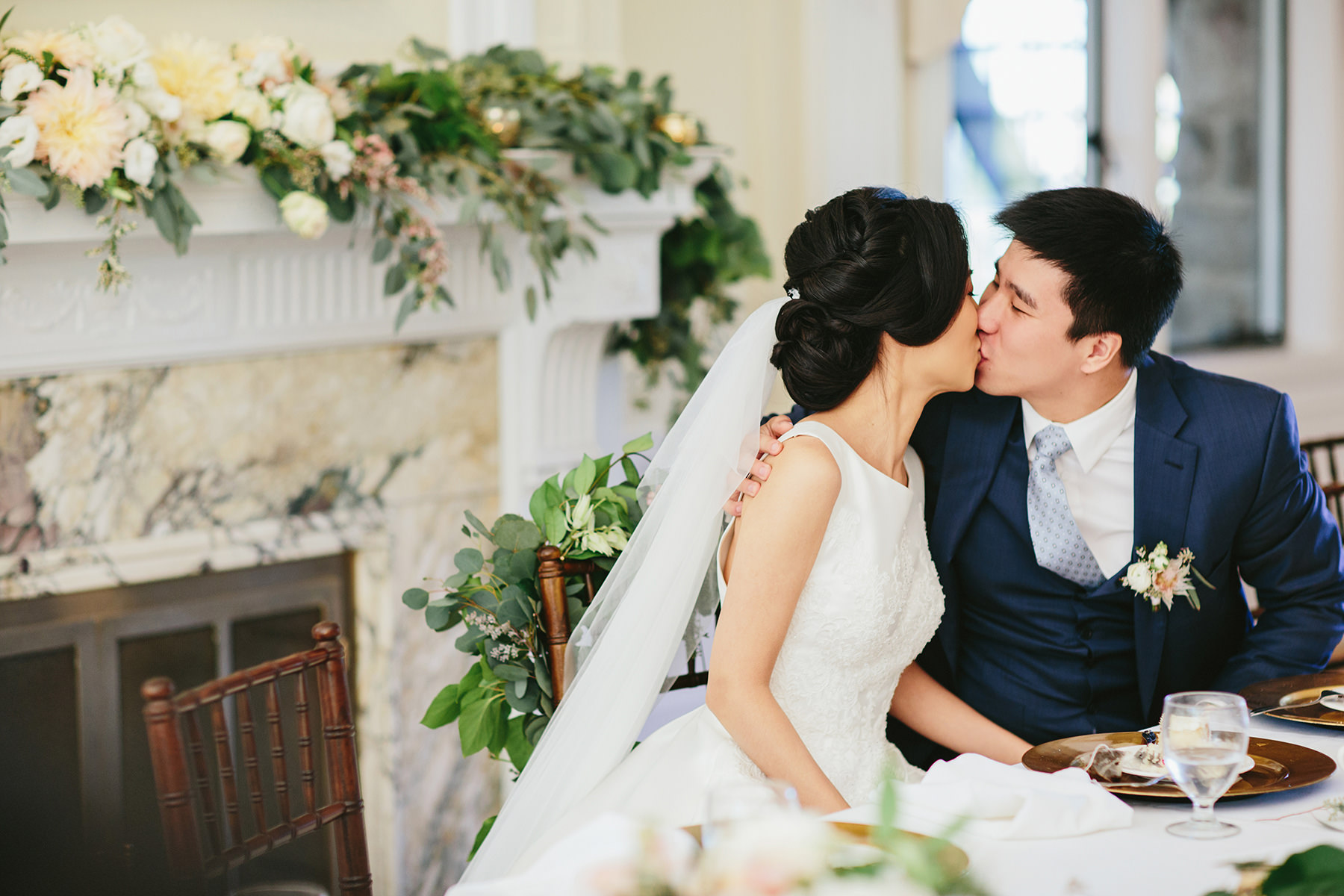 bride and groom share a kiss at cecil green park house in Vancouver BC www.lucida-photography.com