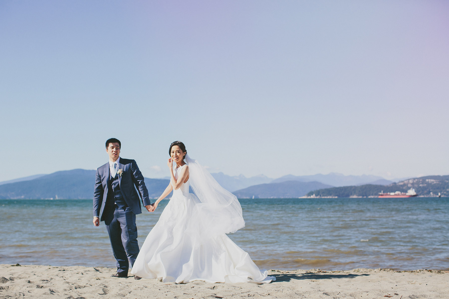 bride and groom on Jericho beach in Vancouver www.lucida-photography.com