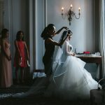bride puts gets dressed and has veil pinned in georgian room of vancouver club www.lucida-photography.com